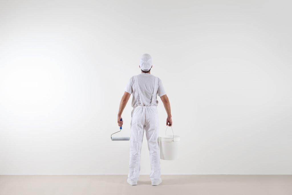 painter decorator holding trade paint